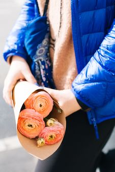 Free Pink Ranunculus Flower Bouquet On Persons Hand Wearing Blue Zip-up Jacket Stock Image - 109920941