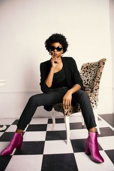 Free Woman In Black Blazer And Dress Pants Sitting On Chair Royalty Free Stock Photography - 109920987