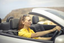 Free Woman In Yellow Shirt Driving A Silver Car Stock Photography - 109921052