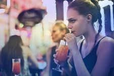 Free Woman Wearing Black Spaghetti Strap Top And Sipping Drink Royalty Free Stock Images - 109921109