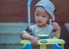 Free Boy Sitting On Yellow And Blue Trike Royalty Free Stock Images - 109921169