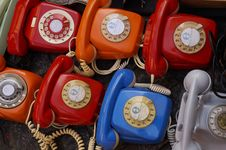 Free Seven Assorted Colored Rotary Telephones Stock Images - 109921234