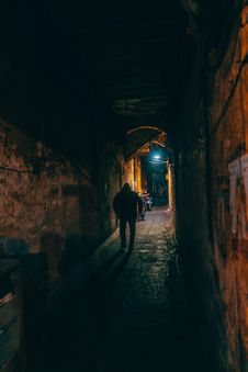 Free Photo Of Person Walking Along Brown Wall Tunnel Stock Images - 109921334