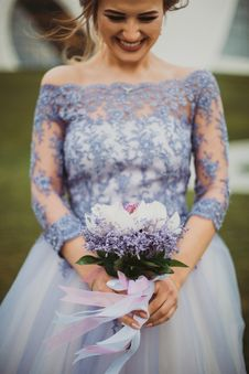 Free Shallow Focus On Purple Floral Off-shoulder Long-sleeved Lace Wedding Gown Royalty Free Stock Photos - 109921388