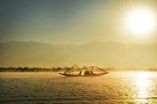 Free Group Of People Riding Boat In The Middle Of Water During Sunrise Stock Images - 109921484