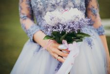 Free Woman In Blue Gown Holding Bouquet Of Flowers Royalty Free Stock Photo - 109921555
