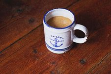 Free White And Blue Sailor Ceramic Coffee Mug On Brown Wooden Surface Royalty Free Stock Image - 109921636