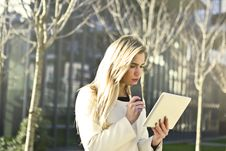 Free Brown-haired Woman Holding A White Wireless Device Stock Image - 109921671