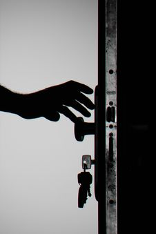Free Silhouette Photo Of Person Holding Door Knob Royalty Free Stock Photo - 109921795