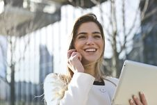 Free Woman In White Blazer Holding Tablet Computer Stock Images - 109921804