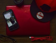 Free Red And Black New Era 9fifty Snapback Cap And Black Samsung Galaxy Android Smartphone Stock Photo - 109921860