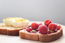 Free Two Boiled Egg And Raspberries On Loaf Bread Stock Photography - 109921952