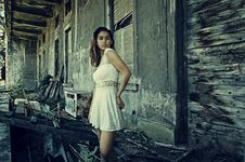 Free Photo Of Woman Wearing White Dress Standing Near Abandoned Building Stock Photography - 109922082