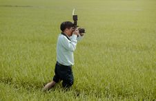 Free Man Standing On Rice Field Holding Camera Royalty Free Stock Images - 109922219
