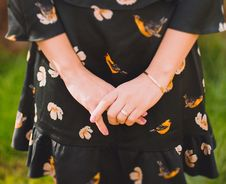 Free Close Up Photo Of Person Wearing Black And Orange Floral Dress Stock Photography - 109922222