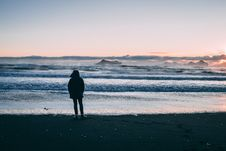 Free Person Standing On Beach Seashore During Sunset Royalty Free Stock Photography - 109922337