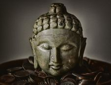 Free Gautama Buddha Bust Surrounded By Coins Royalty Free Stock Photos - 109922368