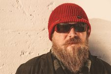 Free Bearded Man Wearing Red Beanie Cap, Sunglasses ,and Black Jacket Stock Image - 109922461