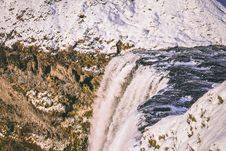 Free Water Falls Beside Mountains With Snow Stock Photography - 109922512
