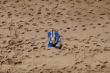 Free Woman In Blue 2-piece Set Lying On Blue Blanket At Beach On Aerial Photo Royalty Free Stock Photography - 109922537