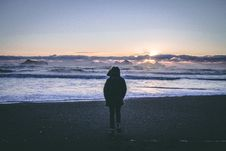 Free Person In Black Hoodie Near Seashore During Sunset Stock Image - 109922581