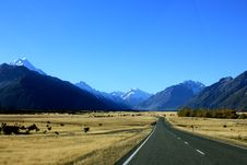 Free Empty Road Near Mountain Under Blue Skies Stock Image - 109922681
