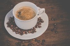 Free A Cup Of Coffee On Brown Wooden Table With Coffee Seeds Royalty Free Stock Image - 109922816