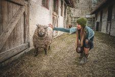 Free Woman Wearing Beanie Beside Sheep Royalty Free Stock Photos - 109922898