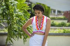 Free Woman In White Plunging Neckline Top And White Skirt Stock Images - 109922974