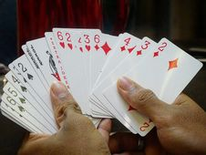 Free Gaming Cards On Hands Royalty Free Stock Photography - 109923027