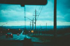 Free Road With Light Posts From Inside Car S Point Of View Royalty Free Stock Photo - 109923075