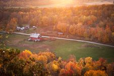 Free Aerial View Of Red And White Painted Barn Near Green Grass Yard Stock Photos - 109923283