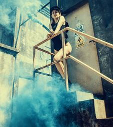 Free Woman In Black One Piece Swimsuit On Stairs Stock Photography - 109923512