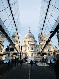 Free White Dome Cathedral In Between Curtain Wall Building At Daytime Royalty Free Stock Photography - 109923547
