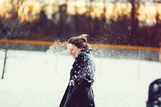Free Woman In Black Coat Hit With Snowball On The Head Stock Photos - 109923573