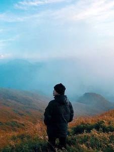 Free Man In Black Jacket Standing On Mountain With Fog Stock Image - 109923631