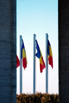 Free Three Blue-yellow-and-red Flags On Gray Pole Royalty Free Stock Image - 109923666
