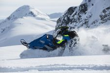 Free Person Riding On Snowmobile Stock Photography - 109923752