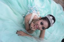 Free Woman Wears Teal Chiffon Gown And Crown Royalty Free Stock Images - 109923779