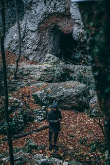 Free Man In Black Coat Standing Near Cave Royalty Free Stock Photo - 109923795