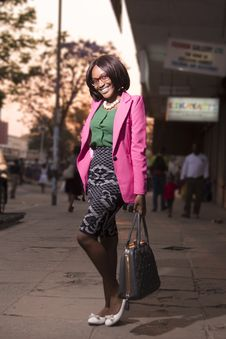 Free Woman In Pink Formal Coat And Green And Gray Dress With Black Hand Bag Royalty Free Stock Photography - 109923847