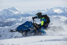 Free Man In Blue And Green Long-sleeved Suit Riding On Snowmobile Royalty Free Stock Photos - 109923848