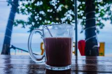 Free Clear Glass Mug With Beverage On Brown Wooden Table Royalty Free Stock Photos - 109923908