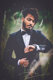 Free Man In Tuxedo Suit Surrounded By Grass Stock Image - 109923991