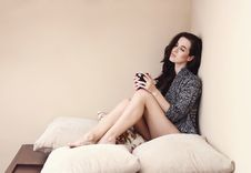 Free Woman In Gray Cardigan Sitting On Bed Royalty Free Stock Photography - 109924107