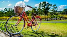 Free Red Cruiser Bike Parked On Metal Bike Stand Stock Photos - 109924173