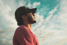 Free Man Wearing Black Cap With Eyes Closed Under Cloudy Sky Royalty Free Stock Photos - 109924368