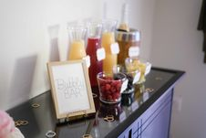 Free Bubbly Bar Sign With Several Assorted-color Liquid With Bottles On Top Of Black Wooden Table Stock Photo - 109924420