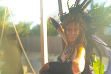 Free Woman Wearing Blue Spaghetti-strap Top With Feather Headdress Stock Photos - 109924483