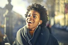 Free Close-up Photo Of A Woman Listening To Music Stock Photos - 109924703
